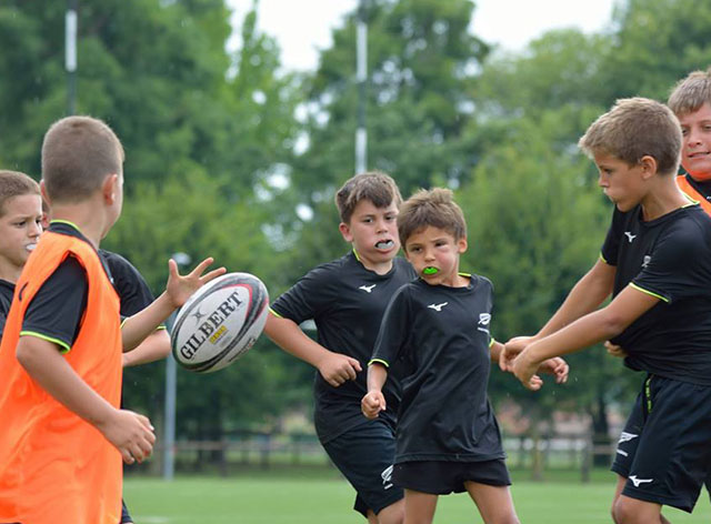 Mizuno Italy donated T shirts to boys participating Rugby Camps